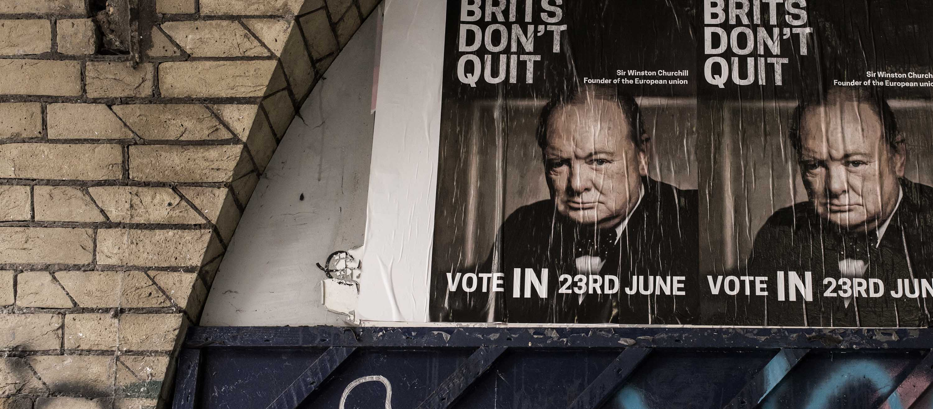 "London, United Kingdom - June 20, 2016: Posters in favor of a vote to remain in the European Union with Winston Churchill's face and the words ""Brits don't Quit"". The referendum on the 23rd June 2016 will decide whether the UK should remain a member of the EU."