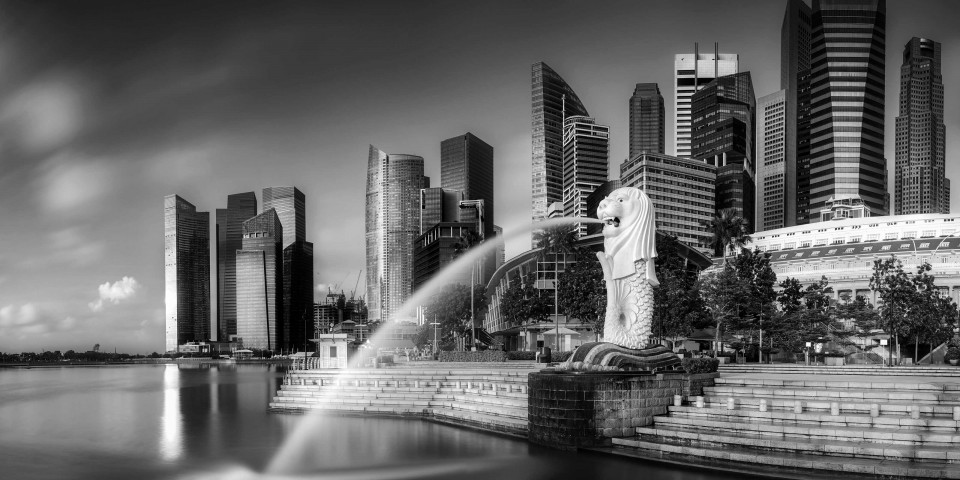 SINGAPORE CITY, SINGAPORE: APRIL 12, 2015: Sunrise at Merlion and Singapore city skyline with Singapore Flyer